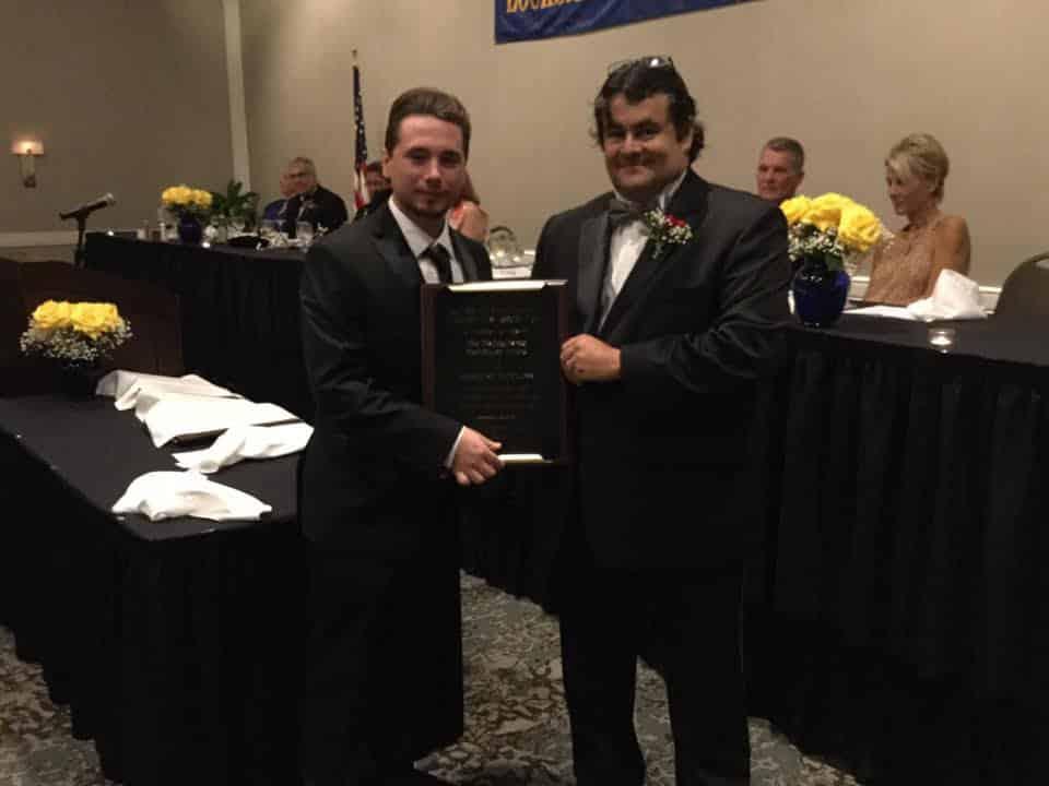Distinguished Distributor Award presents by Paul Kline (L) to Midwest Key